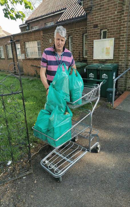 Manna Food Bank volunteer delivers a parcel