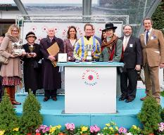 HRH The Princess Royal present Jockey with winners trophy